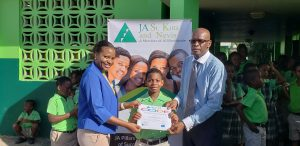 Student receiving certificate from ICWI Rep. Nordia Dobbs (L) and Permanent Secretary-Education, William Hodge, (R)