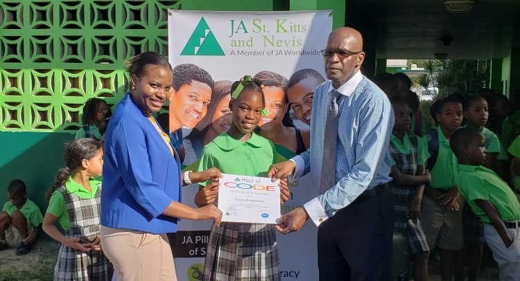 Nordia Dobbs of ICWI, (L) and Permanent Secretary, William Hodge, presenting certificate to student