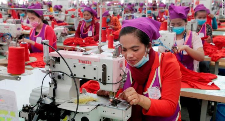 Garment workers sew clothes in a factory outside of Phnom Penh, Cambodia, on August 30, 2017.